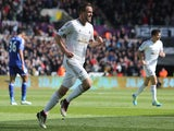 Gylfi Sigurdsson celebrates opening the scoring during the Premier League game between Swansea City and Chelsea on April 9, 2016