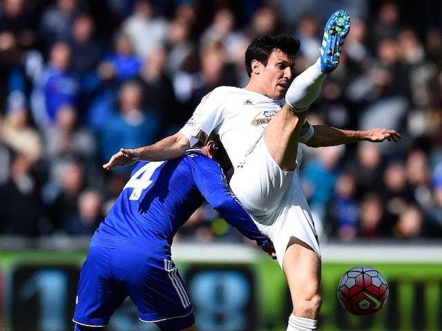 Big Jack Cork and Cesc Fabregas in action during the Premier League game between Swansea City and Chelsea on April 9, 2016