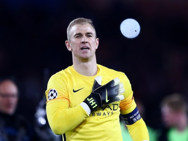 Joe 'head and shoulders' Hart applauds supporters during the Champions League quarter-final between Paris Saint-Germain and Manchester City on April 6, 2016