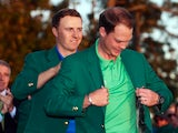 Jordan Spieth hands Danny Willett his green jacket at The Masters on April 10, 2016