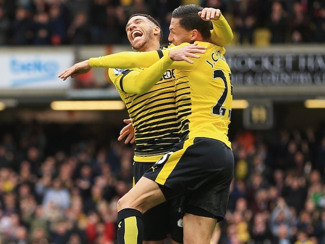 Jose Holebas celebrates the equaliser with Etienne Capoue during the Premier League game between Watford and Everton on April 9, 2016