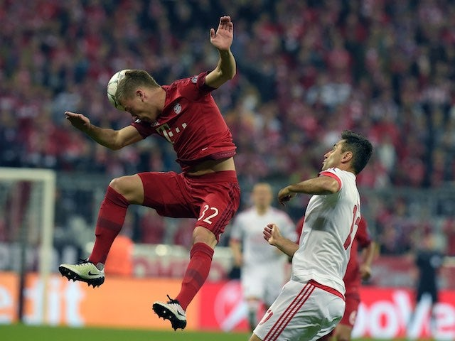 Joshua Kimmich and Jonas in action during the Champions League quarter-final between Bayern Munich and Benfica on April 5, 2016