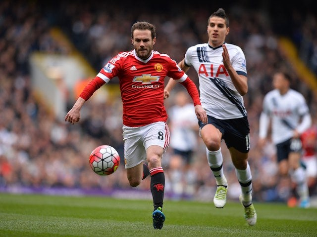 Juan Mata and Erik Lamela in action during the Premier League game between Tottenham Hotspur and Manchester United on April 10, 2016