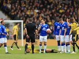 Leighton Baines has a word with Kevin Friend during the Premier League game between Watford and Everton on April 9, 2016