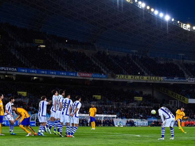 Lionel Messi takes a free kick during the La Liga game between Real Sociedad and Barcelona on April 9, 2016