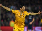Luis Suarez celebrates scoring again during the Champions League quarter-final between Barcelona and Atletico Madrid on April 5, 2016