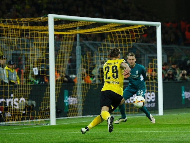 Marcel Schmelzer charges at Simon Mignolet during the Europa League quarter-final between Borussia Dortmund and Liverpool on April 7, 2016