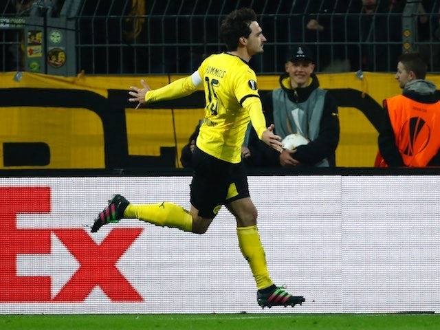 Mats Hummels celebrates his equaliser during the Europa League quarter-final between Borussia Dortmund and Liverpool on April 7, 2016
