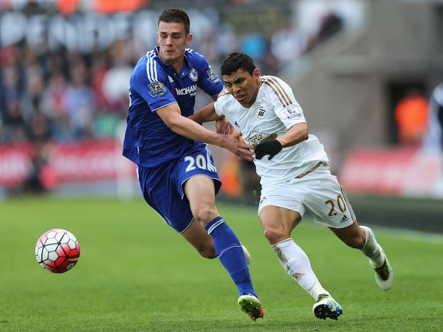 Matt Miazga gives Jefferson Montero a tug during the Premier League game between Swansea City and Chelsea on April 9, 2016