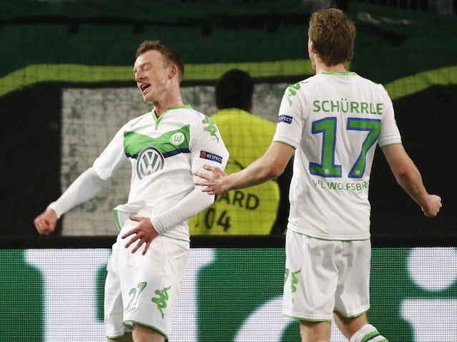 Maximilian Arnold celebrates doubling the lead during the Champions League quarter-final between Wolfsburg and Real Madrid on April 6, 2016