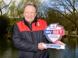 Neil 'three for a tenner' Warnock poses with his Championship manager of the month award for March 2016