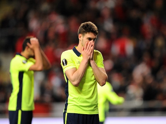 Nikola Vukcevic misses an opportunity and reacts by covering his mouth with both hands while wearing a fluorescent shirt during the Europa League quarter-final between Braga and Shakhtar Donetsk on April 7, 2016