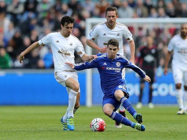 Oscar holds off Jack Cork during the Premier League game between Swansea City and Chelsea on April 9, 2016