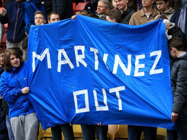 Supporters protest against Roberto Martinez during the Premier League game between Watford and Everton on April 9, 2016