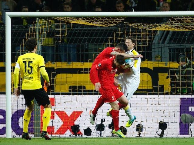 Roman Weidenfeller collides with Dejan Lovren during the Europa League quarter-final between Borussia Dortmund and Liverpool on April 7, 2016