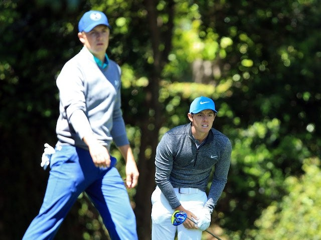 Rory McIlroy and Jordan Spieth in action during round three of The Masters on April 9, 2016