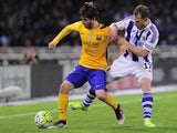 Sergi Roberto jostles with David Zurutuza during the La Liga game between Real Sociedad and Barcelona on April 9, 2016