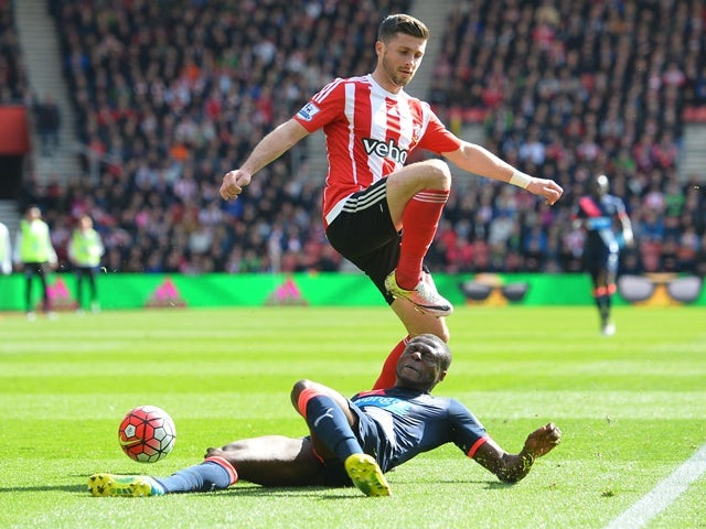 Shane Long and Chancel Mbemba during the Premier League match between Southampton and Newcastle United on April 9, 2016