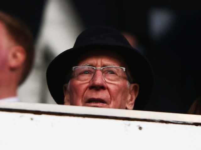 Sir Bobby Charlton plays peek-a-boo during the Premier League game between Tottenham Hotspur and Manchester United on April 10, 2016