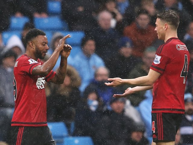 Stephane Sessegnon celebrates with James Chester during the Premier League game between Manchester City and West Bromwich Albion on April 9, 2016