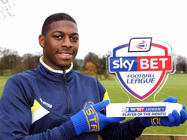 Sullay 'let's have a' KaiKai poses with his League One player of the month award for March 2016
