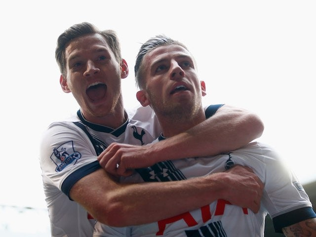Toby Alderweireld and Jan Vertonghen celebrate during the Premier League game between Tottenham Hotspur and Manchester United on April 10, 2016