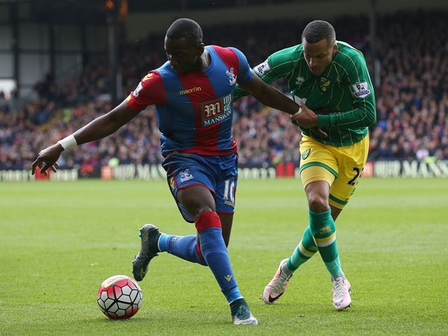 Yannick Bolasie and Martin Olsson in action during the Premier League match between Crystal Palace and Norwich City on April 9, 2016