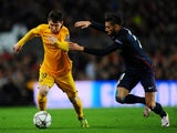 Yannick Carrasco and Lionel Messi in action during the Champions League quarter-final between Barcelona and Atletico Madrid on April 5, 2016