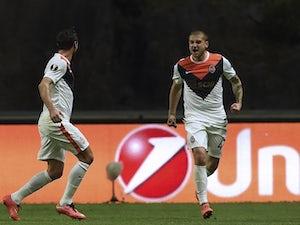 Yaroslav Rakitskiy celebrates scoring with Darijo Srna during the Europa League quarter-final between Braga and Shakhtar Donetsk on April 7, 2016