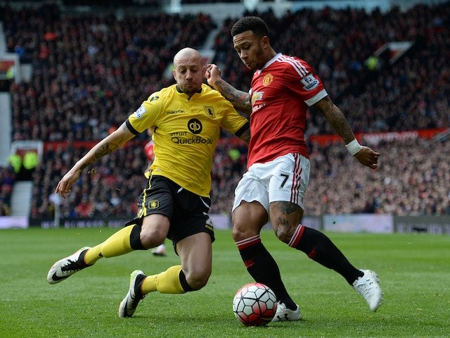 Alan Hutton and Memphis 'who ate all' Depay in action during the Premier League game between Manchester United and Aston Villa on April 16, 2016