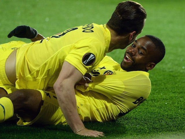 Cedric Bakambu and Roberto Soldado get into the missionary position after scoring during the Europa League quarter-final between Sparta Prague and Villarreal on April 14, 2016