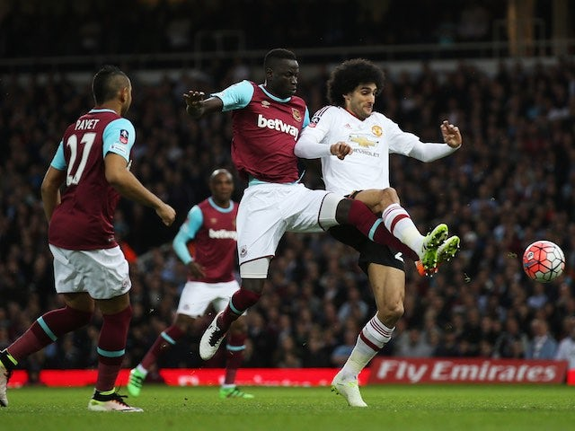 Cheikhou Kouyate and Marouane Fellaini in action during the FA Cup replay between West Ham United and Manchester United on April 13, 2016