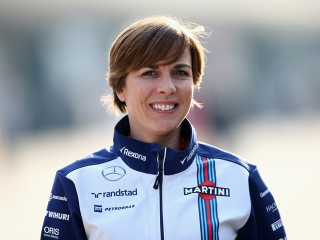 Claire Williams smiles as she walks through the paddock after practice for the Formula One Grand Prix of China at Shanghai International Circuit on April 10, 2015