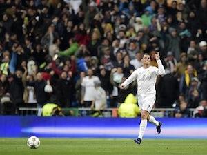 Ronaldo hat-trick sees Real Madrid through