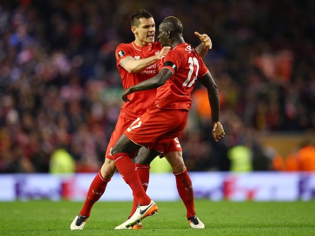 Dejan Lovren celebrates with Mamadou Sakho during the Europa League quarter-final between Liverpool and Borussia Dortmund on April 14, 2016