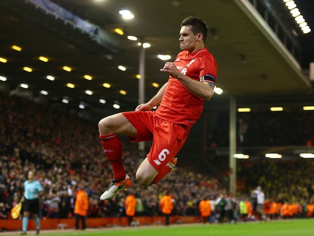 Dejan Lovren celebrates his match winner during the Europa League quarter-final between Liverpool and Borussia Dortmund on April 14, 2016