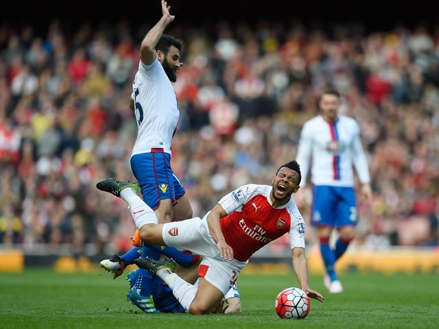 Francis Coquelin is tackled by Yohan Cabaye during the Premier League game between Arsenal and Crystal Palace on April 17, 2016