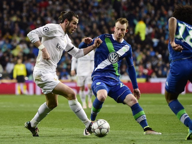 Gareth Bale and Maximilian Arnold in action during the Champions League quarter-final between Real Madrid and Wolfsburg on April 12, 2016