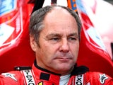 Former driver Gerhard Berger sits in a car on track after qualifying for the Formula One Grand Prix of Austria at Red Bull Ring on June 20, 2015