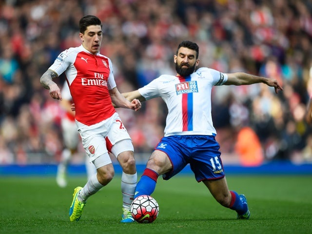 Hector Bellerin is tackled by Mile Jedinak during the Premier League game between Arsenal and Crystal Palace on April 17, 2016