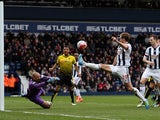 Heurelho Gomes makes a diving save during the Premier League match between West Bromwich Albion and Watford on April 16, 2016