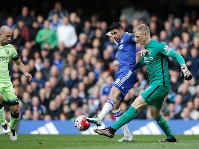 Joe Hart vies with Diego Costa during the Premier League game between Chelsea and Manchester City on April 16, 2016