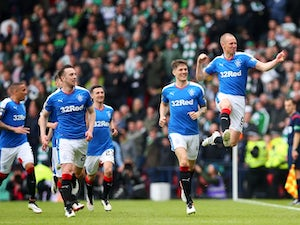 Rangers players celebrate Kenny Miller's goal in the Scottish Cup semi-final against Celtic on April 17, 2016