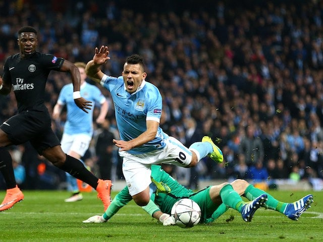 Kevin Trapp brings down Sergio Aguero for a pen during the Champions League quarter-final between Manchester City and Paris Saint-Germain on April 12, 2016