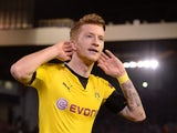 Marco 'Rolls' Reus celebrates scoring during the Europa League quarter-final between Liverpool and Borussia Dortmund on April 14, 2016