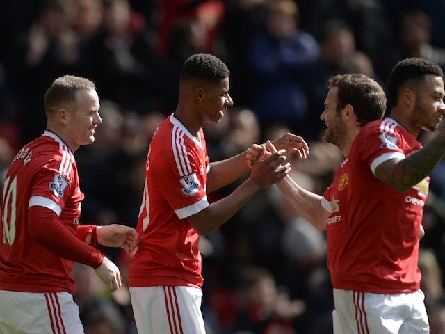 Marcus Rashford is congratulated by Juan Mata after scoring during the Premier League game between Manchester United and Aston Villa on April 16, 2016