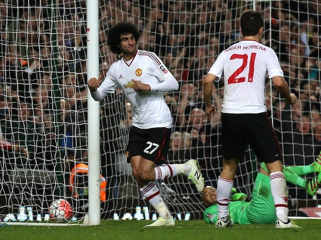 Marouane Fellaini celebrates scoring during the FA Cup replay between West Ham United and Manchester United on April 13, 2016