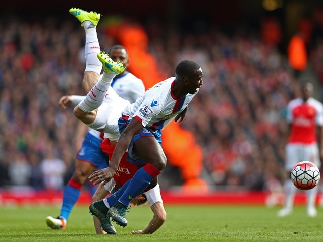 Nacho Monreal is upended by Yannick Bolasie during the Premier League game between Arsenal and Crystal Palace on April 17, 2016