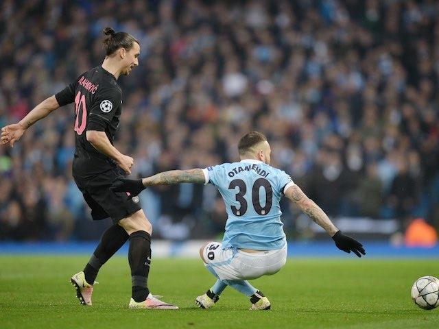 Nicolas Otamendi holds off Zlatan Ibrahimovic during the Champions League quarter-final between Manchester City and Paris Saint-Germain on April 12, 2016