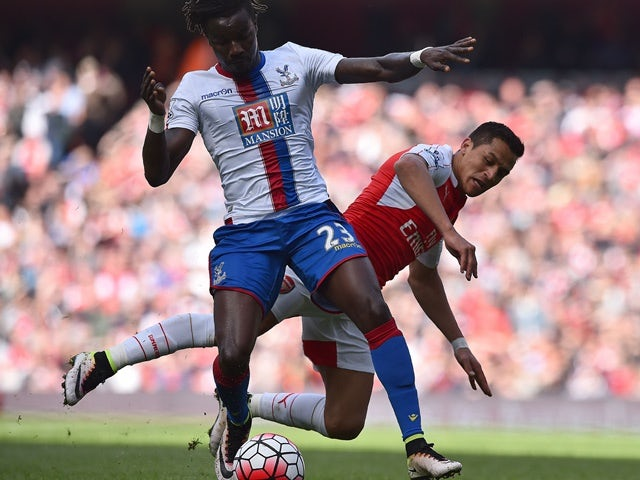 Pape Souare and Alexis Sanchez vie for the ball during the Premier League game between Arsenal and Crystal Palace on April 17, 2016